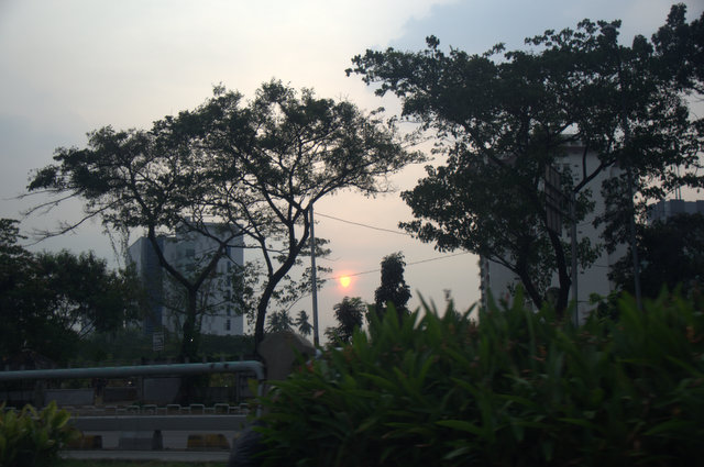 Jakarta sunset from inside our taxi.