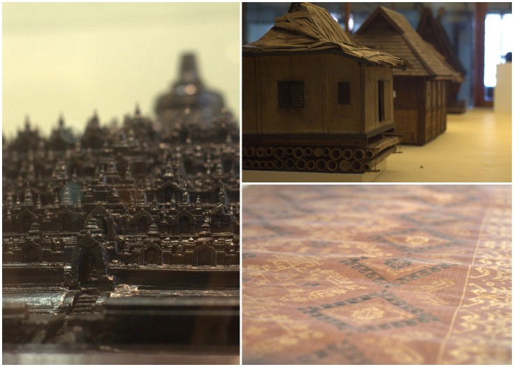 A batik and models of a temple complex and traditional Indonesian houses.
